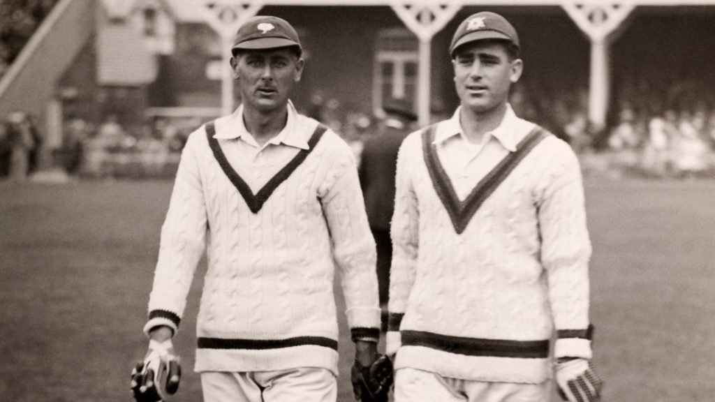 Hedley Verity (L) and Bill Voce walk out to bat during the Scarborough Cricket Festival, circa 1936