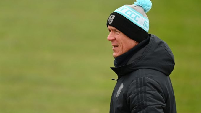 Surrey director of cricket Alec Stewart stands in as square-leg umpire in County Championship fixture